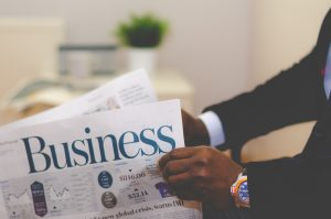A man reading a business newspaper