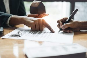 Commercial Real estate agent and customers negotiating over lease terms