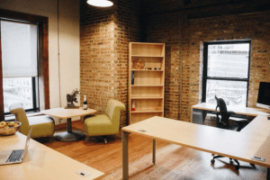 A private office interior with brick walls