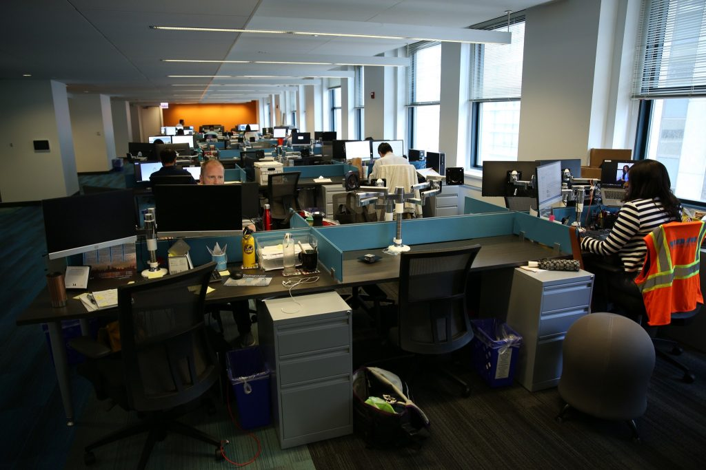 An office space partially filled with employees