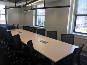 A long table in an office meeting room