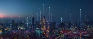 A digital abstract overlay on a city skyline at night