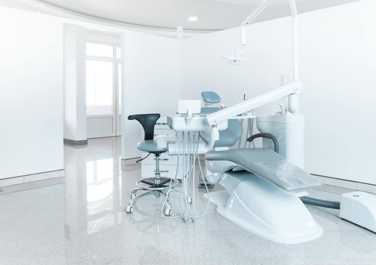 An empty patient room of a dental office