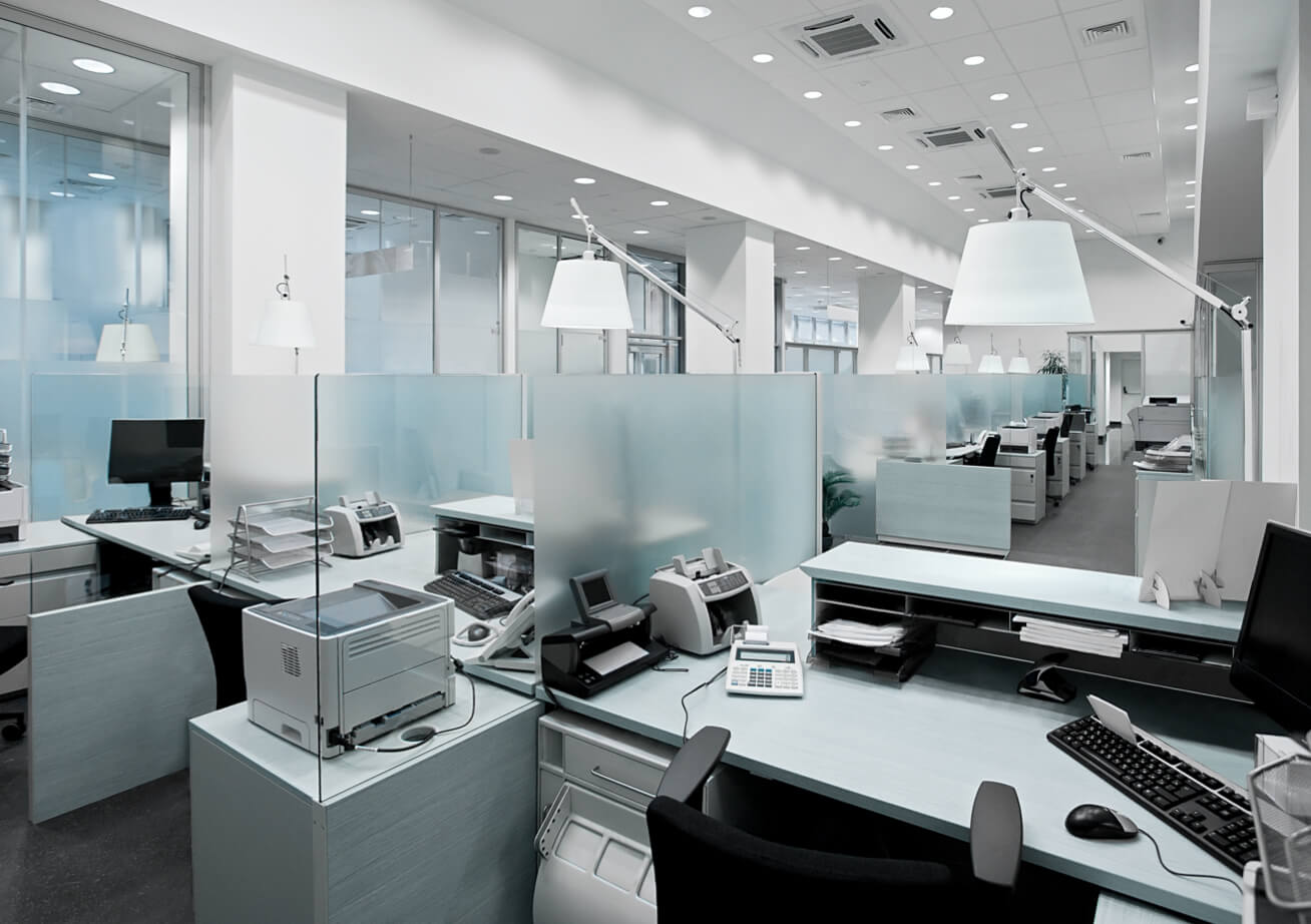 empty office cubicles with glass dividers