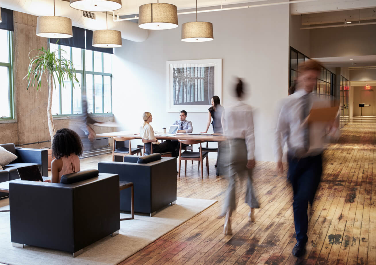 Employees conversing in a comfortable homelike not-for-profit office space