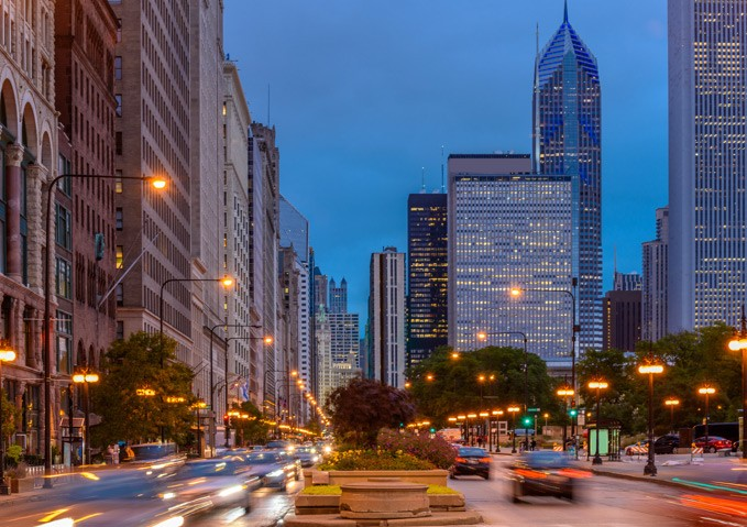 An evening view of Michigan Avenue with traffic wizzing by