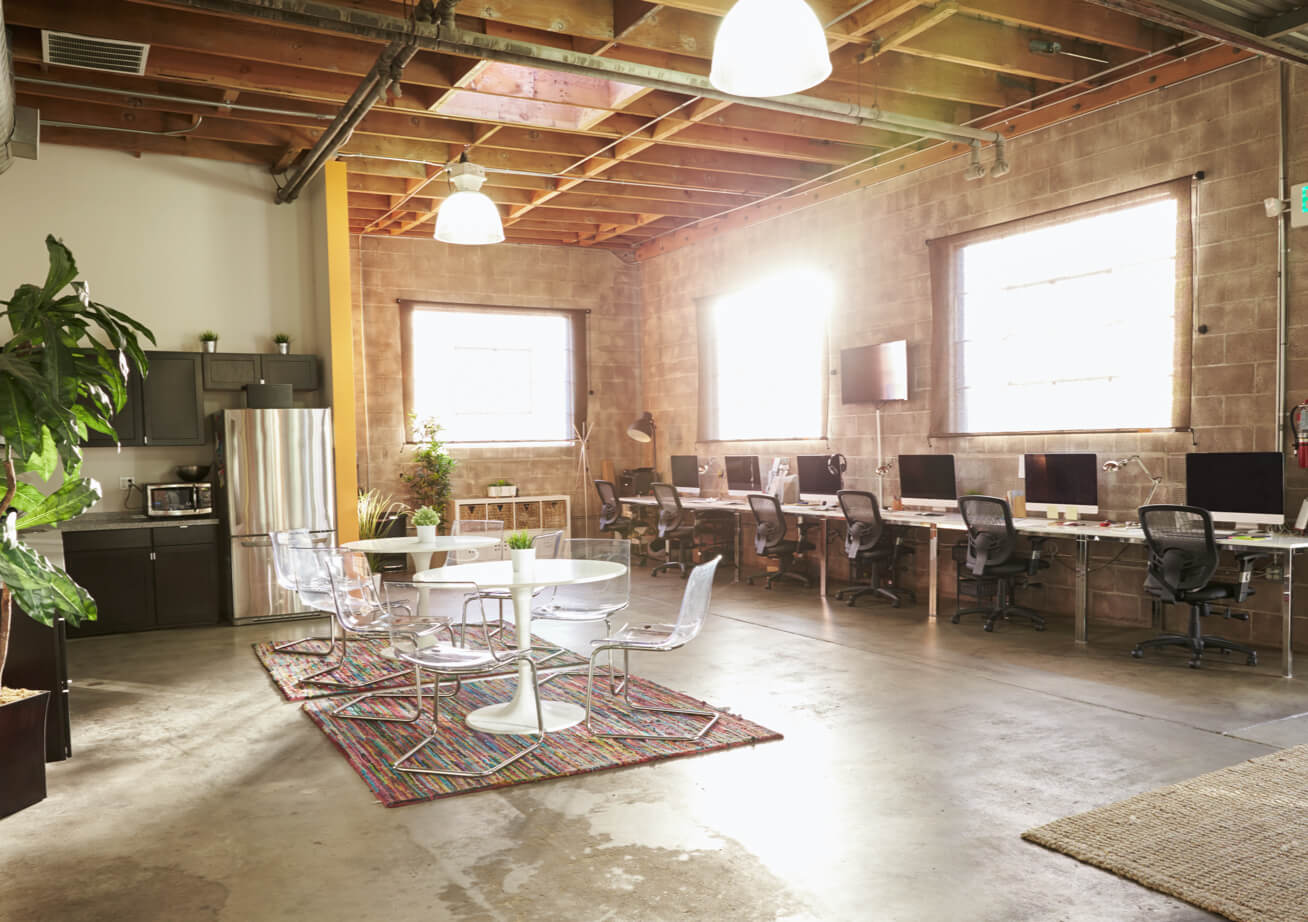 A bright naturally lit rustic interior of a startup office