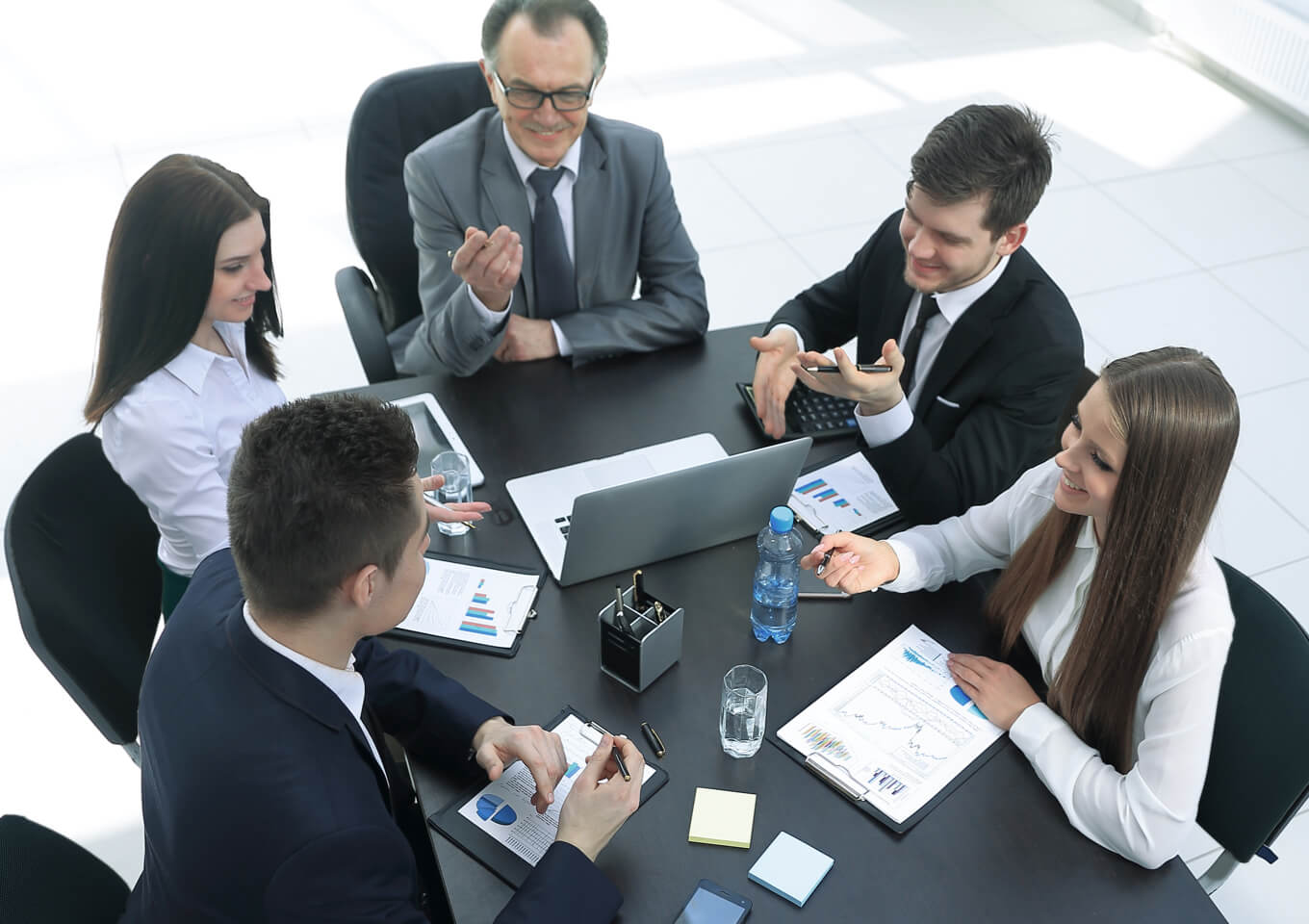 a group of realtors and clients renegotiate a lease at a meeting table